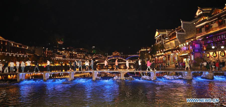 Tourists go sightseeing at Fenghuang old town in Fenghuang County, central China\'s Hunan Province, Sept. 7, 2018. Fenghuang, which means \