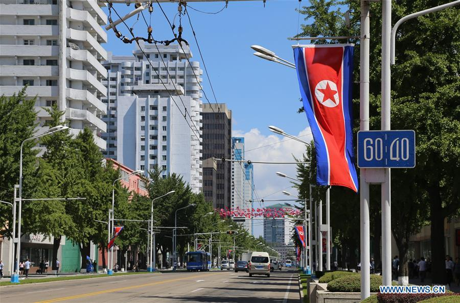 Photo taken on Sept. 8, 2018 shows an avenue decorated with national flags in Pyongyang, capital of the Democratic People\'s Republic of Korea (DPRK). Sept. 9, 2018 marks the 70th anniversary of the founding of the DPRK. (Xinhua/Jiang Yaping)