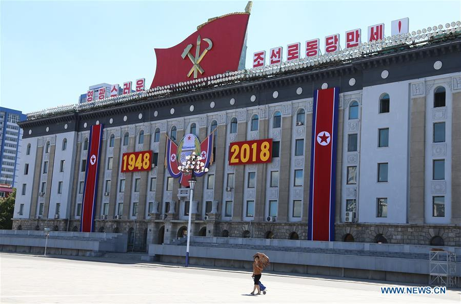 Photo taken on Sept. 8, 2018 shows a resident walking at Kim Il Sung Square in Pyongyang, capital of the Democratic People\'s Republic of Korea (DPRK). Sept. 9, 2018 marks the 70th anniversary of the founding of the DPRK. (Xinhua/Jiang Yaping)