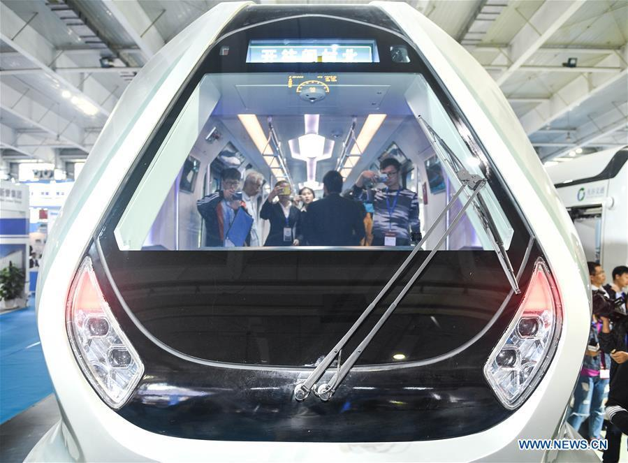 People try out a new-generation carbon-fiber light rail train at an exhibition held in Changchun, capital of northeast China\'s Jilin Province, Sept. 7, 2018. The body of the train is made of carbon fiber composite, making it more energy-efficient, according to its manufacturer CRRC Changchun Railway Vehicles Co., Ltd. (Xinhua/Xu Chang)