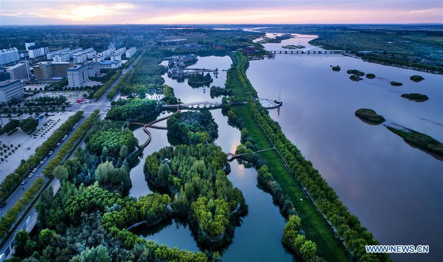 Aerial photo taken on Sept. 7, 2018 shows the scenery of a wetland park along the Heihe River in Gaotai County of Zhangye City, northwest China\'s Gansu Province. (Xinhua/Tao Ming)