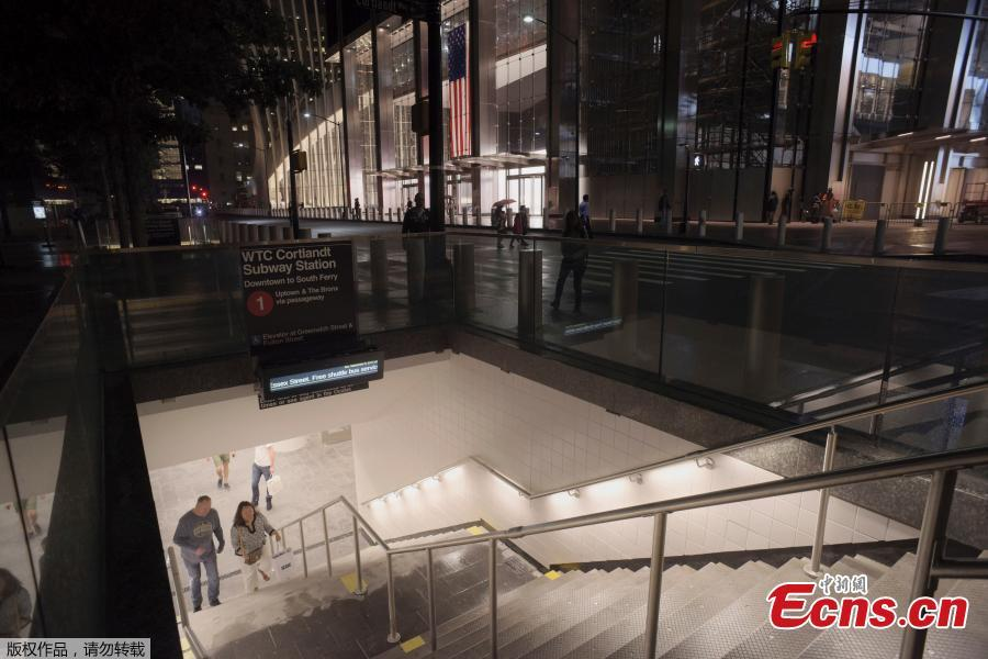 People walk up a flight of stairs in the World Trade Center complex from the newly-opened WTC Cortlandt subway station in New York, Sept. 8, 2018. The old Cortlandt Street station on the subway system\'s No. 1 line was buried under the rubble of the World Trade Center\'s twin towers on Sept. 11, 2001. Construction of the new station was delayed until the rebuilding of the surrounding towers was well under way. The new station cost $181 million and features a mosaic that uses words from the Declaration of Independence. (Photo/Agencies)