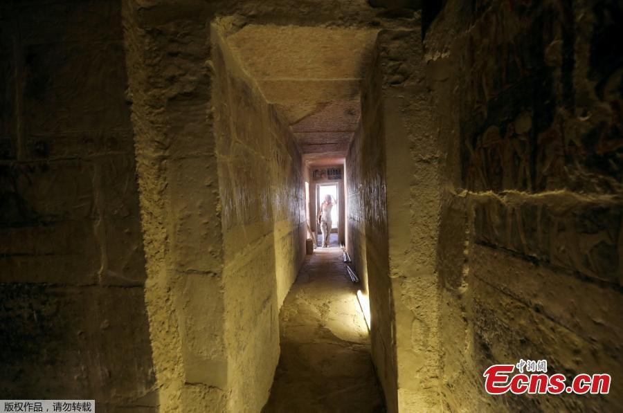 A tourist passes through the entrance of a chamber of the tomb of Mehu after it was opened for the public at Saqqara area near Egypt\'s Saqqara necropolis, in Giza, Egypt September 8, 2018. (Photo/Agencies)