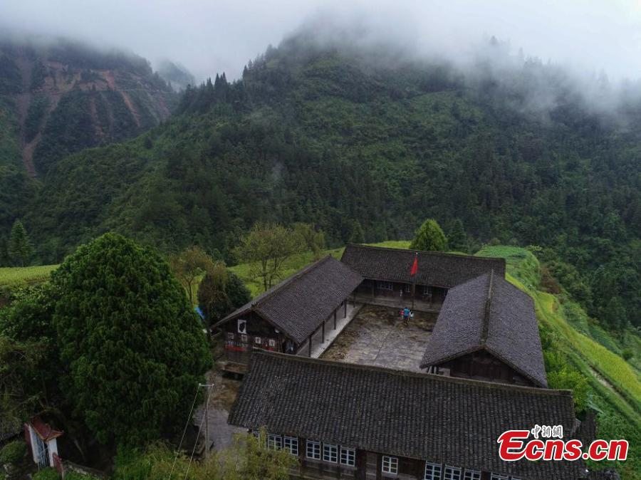 An aerial view of the mountain school in Danggan Village, Paitiao Town, Guizhou Province, Sept. 7, 2018. Yang, 40, is the only teacher in the school that has one first grader and seven pre-school children from nearby villages. If not for the school, children would have to travel to a town more than 20 kilometers away to study. (Photo: China News Service/Huang Xiaohai)