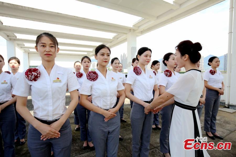Train attendants receive extra training to prepare for the opening of the Guangzhou-Shenzhen-Hong Kong Express Rail Link in Fuzhou City, East China's Fujian Province, Sept. 10, 2018. The XRL runs from a station in West Kowloon, heading north to the Shenzhen/Hong Kong Boundary, where it connects with the mainland section. Fuzhou and Xiamen, both cities in Fujian, will have direct high-speed services between Hong Kong's West Kowloon station. The attendants undergoing training will serve on these trains. (Photo: China News Service/Li Yiming)