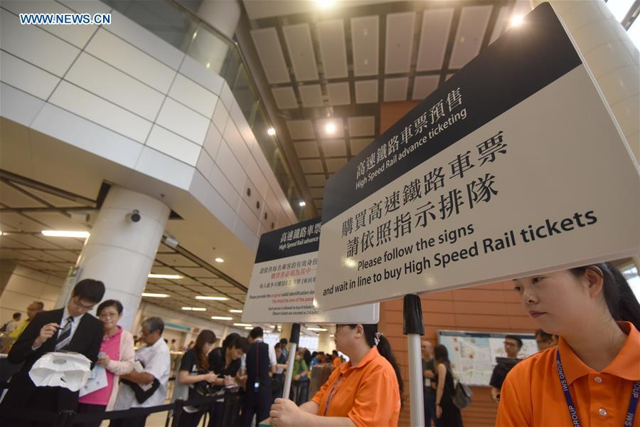 Passengers queue to buy tickets at the Hong Kong West Kowloon Station, in Hong Kong, south China, on Sept. 10, 2018. The Guangzhou-Shenzhen-Hong Kong high-speed railway will officially start operation on Sept. 23. The sale of the tickets began on Monday. (Xinhua/Wang Shen)