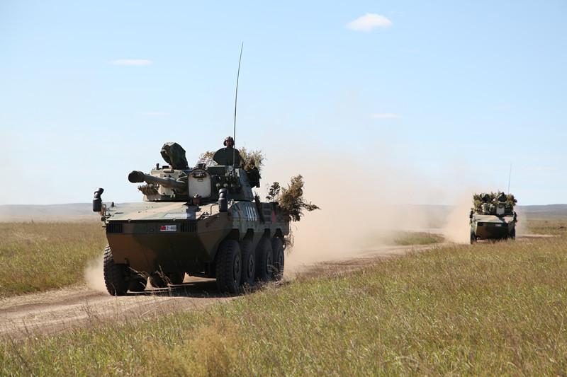 Chinese armed vehicles maneuver at the Tsugol training range in Russia\'s Trans-Baikal region. About 3200 Chinese troops attended the \