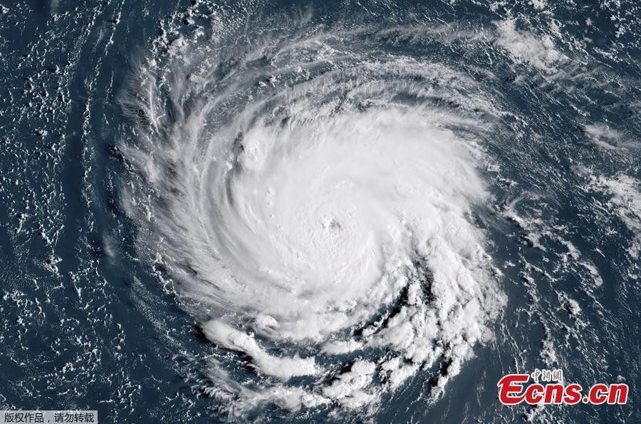 This satellite image taken on September 10, 2018, shows Hurricane Florence off the US east coast in the Atantic Ocean. Hurricane Florence is expected to become a dangerous \