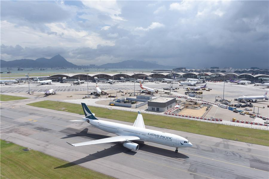 A jet taxies at Hong Kong International Airport at Chek Lap Kok in the New Territories. Last year, the airport had connections to 220 international destinations. More than 120 airlines operated there, handling 73.6 million passengers. PROVIDED TO CHINA DAILY It was 6:30 a.m. on July 6, 1998, when a commercial airliner from New York made the first landing at the newly completed Hong Kong International Airport.  Only five hours before the inaugural flight landed at the new facility-Chek Lap Kok Airport-the final flight took off from Hong Kong\'s aging Kai Tak Airport. The runway lights at Kai Tak were switched off for the last time at 1:20 am that day.  The opening of the new airport built on reclaimed land on the island of Chek Lap Kok was a landmark event, contributing to Hong Kong\'s status in international aviation.  \