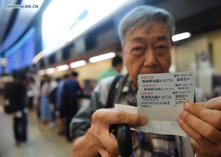A passenger shows high-speed railway tickets from Hong Kong West Kowloon Station to Shenzhen North Station, in Hong Kong, south China, Sept. 10, 2018. The Guangzhou-Shenzhen-Hong Kong high-speed railway will officially start operation on Sept. 23. The sale of the tickets began on Monday. (Xinhua/Wang Shen)