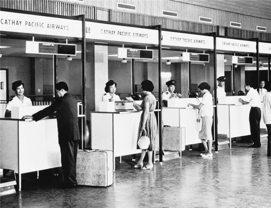 Cathay Pacific check-in desks at Kai Tak Airport in 1962. PHOTO PROVIDED TO CHINA DAILY The airport was a long-awaited replacement for Kai Tak, considered by pilots as one of the most challenging airports in the world.  Pilots had to negotiate steep hills near Kai Tak, often buffeted by challenging crosswinds. The old airport was situated in heavily populated Kowloon City, with a single runway built on reclaimed land extending out to sea.  Kai Tak started to operate in 1930, becoming a key factor in Hong Kong\'s rise to prominence among international air destinations. By the 1960s, traffic had steadily increased, as Western airlines began to operate more flights to the Far East.  In 1993, Kai Tak handled 24.5 million passengers, surpassing its original design capacity. Three years later, it became the world\'s busiest cargo airport, handling 1.56 million tons, and the third-busiest international passenger airport, handling 29.5 million passengers.  By 1993, moves to replace overstretched Kai Tak were moving ahead. The government had announced its plan to build a new and larger airport in 1989. The new facility was destined for Chek Lap Kok, an island off Lantau Island, in the western part of Hong Kong.  Construction began in 1991. The new airport was to be served by nine additional facilities, including a high-speed rail system, a third cross-harbor tunnel linking Hong Kong Island and Kowloon, and the new town of Tung Chung.
