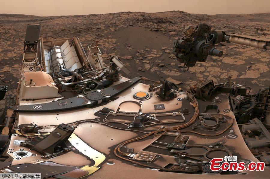 After snagging a new rock sample on Aug. 9, NASA\'s Curiosity rover surveyed its surroundings on Mars, producing a 360-degree panorama of its current location on Vera Rubin Ridge. The panorama includes umber skies, darkened by a fading global dust storm. It also includes a rare view by the Mast Camera of the rover itself, revealing a thin layer of dust on Curiosity\'s deck. (Photo/NASA)