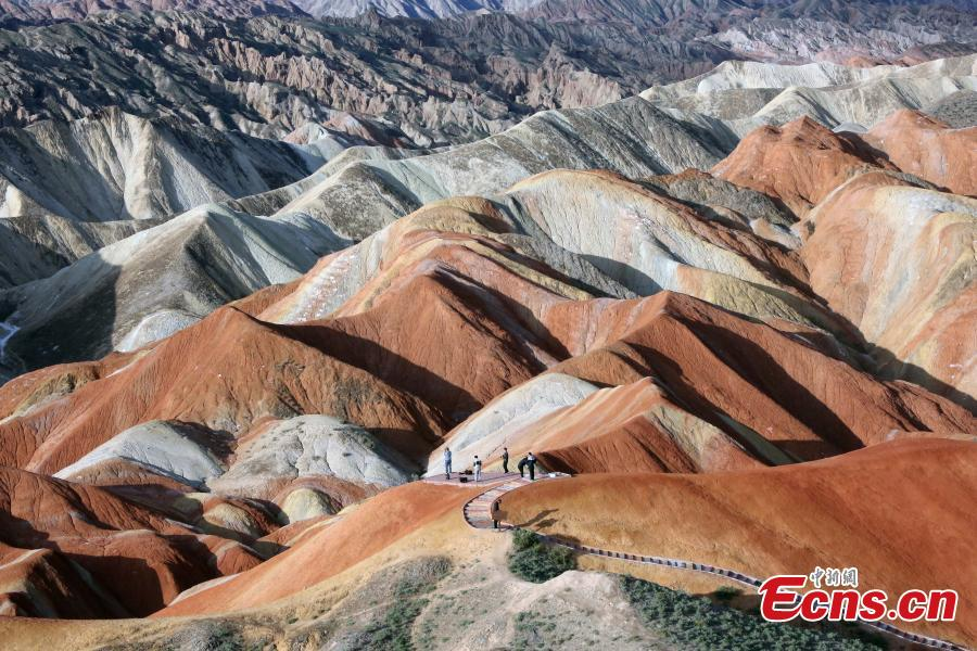 The colorful Danxia landform group, located in Zhangye City, Northwest China's Gansu Province. At an average elevation of 1850 meters, the Danxia landform stretches east to west for 45 kilometers and north to south for 10 kilometers. More than a famous tourist attraction, the Danxia landform has been featured in a number of movies. (Photo: China News Service/Ren Haixia)