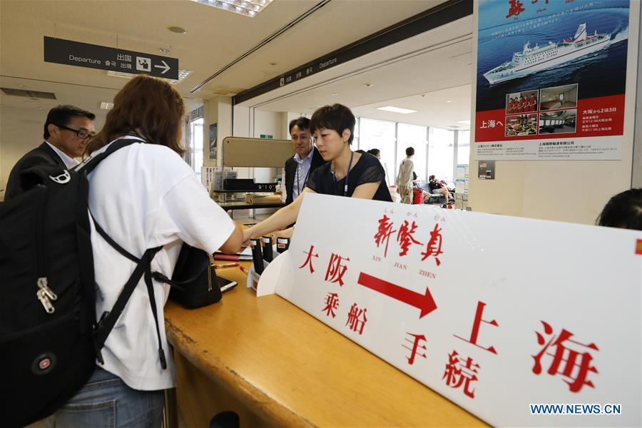 A Chinese passenger buys ticket before boarding the ferry \