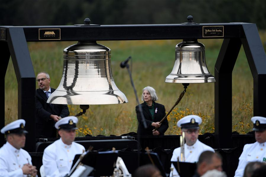 People ring the bells to commemorate the victims of the Flight 93, marking the 17th anniversary of the Sept. 11 attacks, at the Flight 93 National Memorial, in Shanksville, Pennsylvania, the United States, Sept. 11, 2018. (Photo/Xinhua)