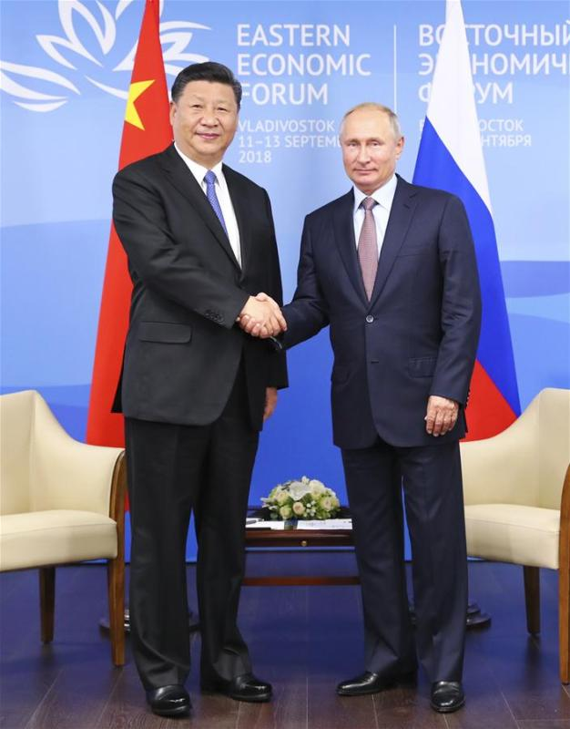Chinese President Xi Jinping (L) holds talks with Russian President Vladimir Putin in Vladivostok, Russia, Sept. 11, 2018. (Xinhua/Huang Jingwen)