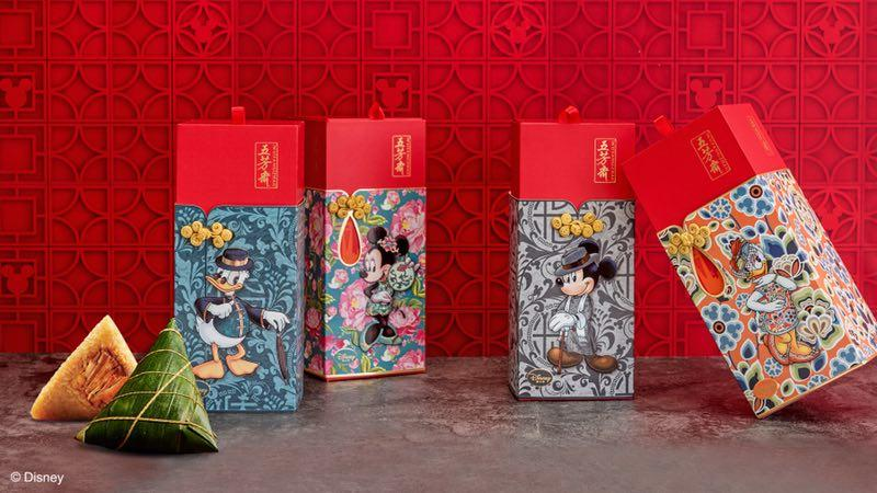 Boxes for zongzi, a Chinese rice treat, are decorated with images of, from left, Donald Duck, Minnie Mouse, Mickey Mouse, and Daisy Duck. (Photo provided to chinadaily.com.cn)