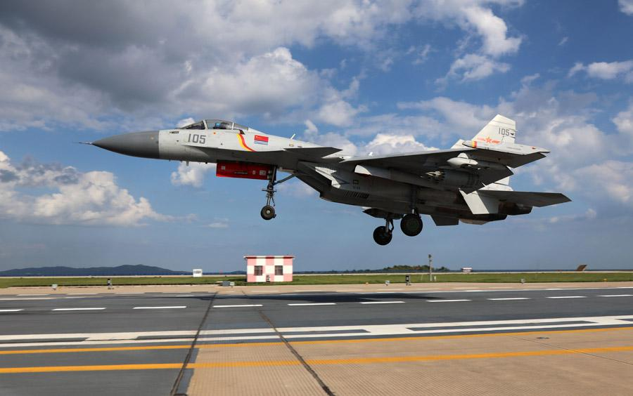 A J-15 fighter jet in training. (Photo provided to chinadaily.com.cn)  The people\'s Liberation Army Navy\'s carrier-based fighter jet force has achieved a number of breakthroughs in its training since May 2013, when it was established.  By now, several batches of Navy pilots have become qualified to take off and land the J-15 fighter jet on the CNS Liaoning aircraft carrier.  Some have been exposed to fierce live-fire exercises that included sophisticated fighting scenarios.  An elite team among the pilots also has carried out night landings, widely considered the riskiest carrier-based action, and have become capable of performing round-the-clock, all-weather operations.