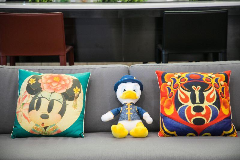 Chinese influences are seen in these Disney items, from left, a Minnie Mouse pillow, Donald Duck stuffed toy and Mickey Mouse pillow. (Photo provided to chinadaily.com.cn)