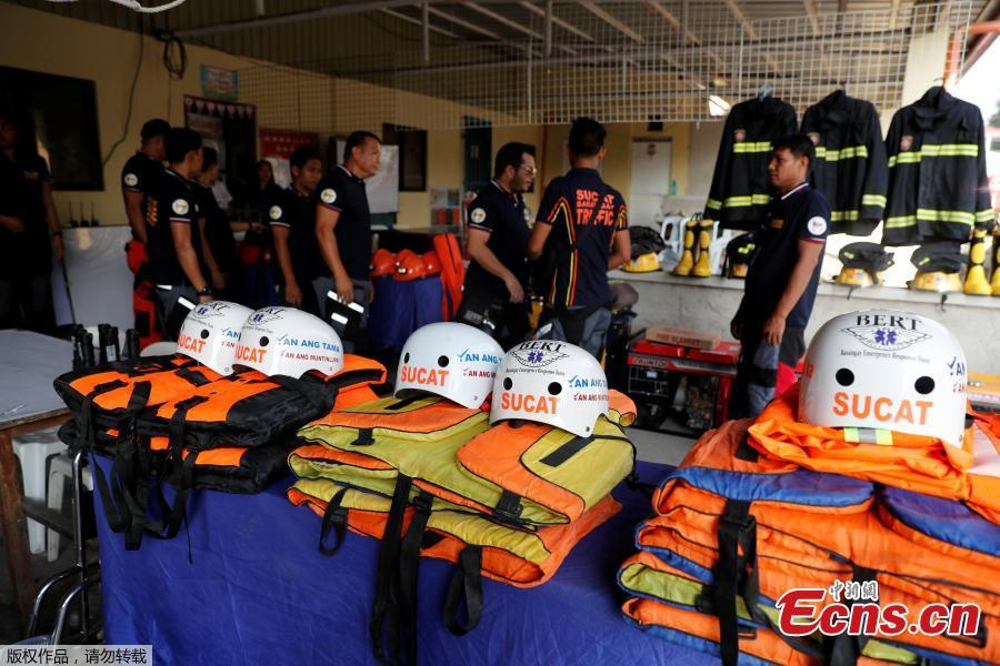 Rescuers ready their gear before Super Typhoon Mangkhut hits the main island of Luzon, in Muntinlupa, Metro Manila, in Philippines, Sept. 13, 2018. (Photo/Agencies)