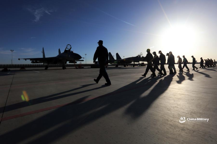 Maintenance men assigned to an aviation brigade of the air force under the PLA Western Theater Command conduct a foreign object debris walk at a military airfield prior to the flight training exercise in the hinterland of the Kunlun Mountains in early September, 2018. (Photo/eng.chinamil.com.cn)