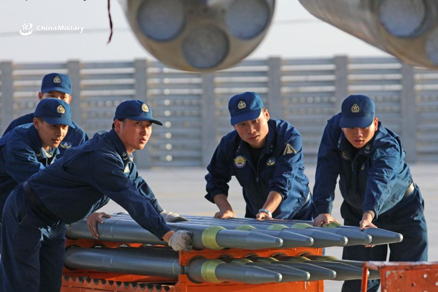 Weapons load crew airmen assigned to an aviation brigade of the air force under the PLA Western Theater Command transfer missiles of J-11 fighter jets prior to the flight training exercise in the hinterland of the Kunlun Mountains in early September, 2018. (Photo/eng.chinamil.com.cn)