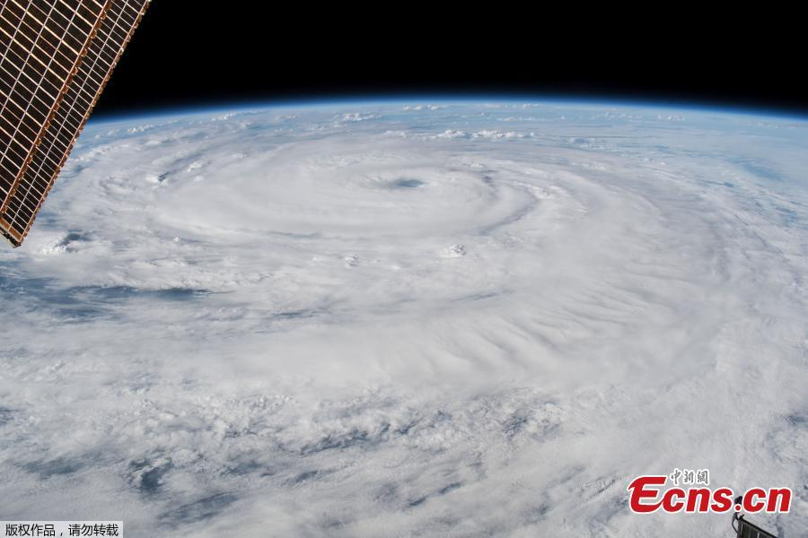 Hurricane Florence gains strength in the Atlantic Ocean as it moves west, seen from the International Space Station. Hurricane Florence, growing in size and intensity, crept closer to the U.S. East Coast on Wednesday as disaster mobilizations expanded south from the Carolinas into Georgia to counter the threat of fierce winds, deadly high seas and calamitous floods. (Photo/Agencies)