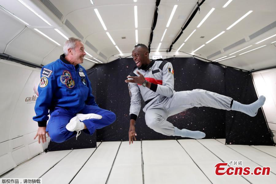 Sprinter Usain Bolt and French astronaut Jean-Francois Clervoy, CEO of Novespace, enjoy zero gravity conditions during a flight in a specially modified plane above Reims, France, Sept. 12, 2018. (Photo/Agencies)