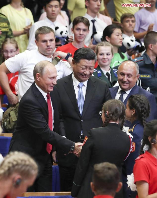 Chinese President Xi Jinping and Russian President Vladimir Putin talk with children at the All-Russian Children\'s Center \