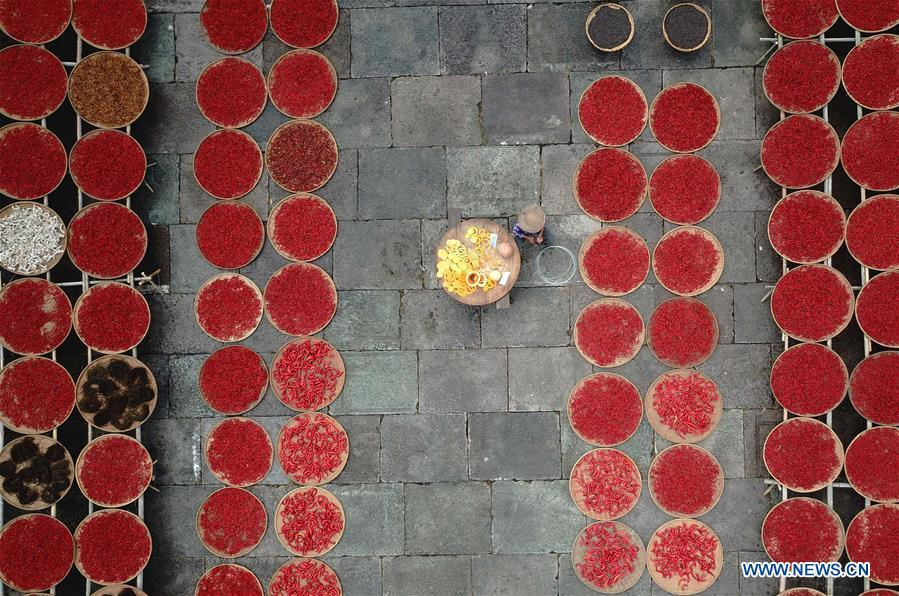 Aerial photo taken on Sept. 12, 2018 shows a villager airing crops at Chengkan Ancient Village in the city of Huangshan, east China\'s Anhui Province. (Xinhua/Shi Yalei)