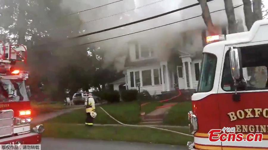 Firefighters work near a building emitting smoke after explosions in North Andover, Massachusetts, United States in this September 13, 2018 still image from social media video footage by Boston Sparks. (Photo/Agencies)