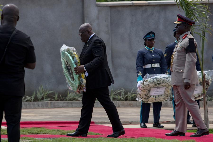 Ghanaian President Nana Akufo-Addo (2nd L) lays a wreath for former UN Secretary-General Kofi Annan during Annan\'s state funeral in Accra, Ghana, on Sept. 13, 2018. A number of African and world leaders joined Ghanaian President Nana Akufo-Addo here on Thursday to bid farewell to former United Nations Secretary-General Kofi Annan, who passed away in Switzerland on Aug. 18. (Xinhua/Fred Bonsu)