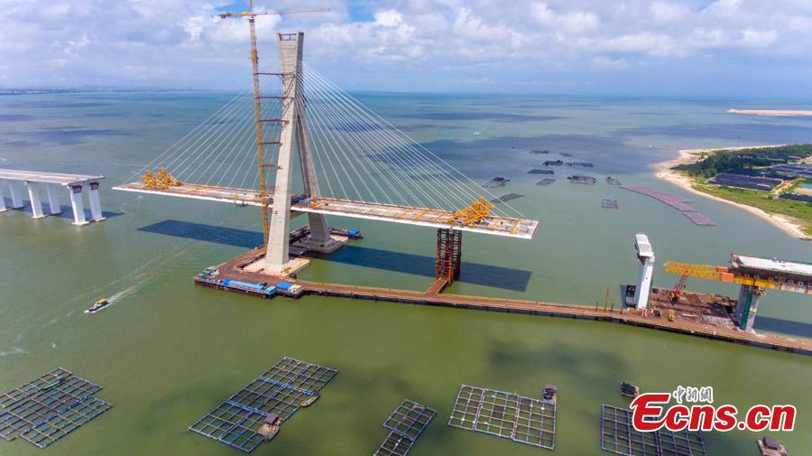 A view of the Puqian Bridge under construction in South China\'s Hainan Province, Sept. 14, 2018. Construction of the cross-sea bridge, scheduled for completion at the end of 2018, will cut the trip from Wenchang City to Haikou City from 90 minutes to about 20 minutes. Spanning a geological fault line, it's being built to the highest standard of earthquake resistance at an investment of 3.01 billion yuan ($440 million). The 5.6-km-long bridge is expected to promote economic growth in the northern part of Hainan Province. (Photo: China News Service/Luo Yunfei)
