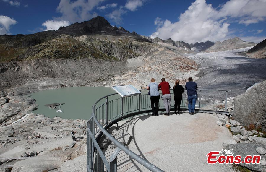 Tourists visit the Rhone Glacier in Furka, Switzerland, September 13, 2018. Glaciologists predict that half of the small glaciers in Switzerland will disappear within the next 25 years. 