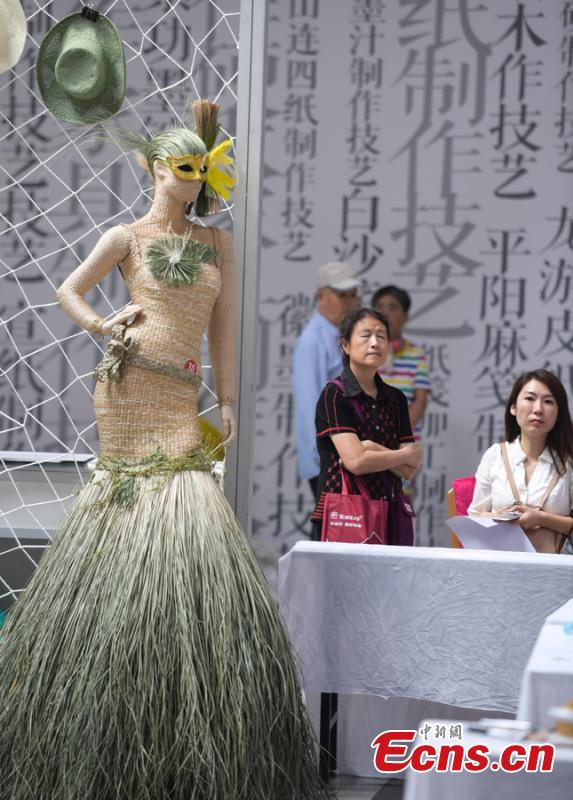 The fifth China Intangible Cultural Heritage Expo, jointly organized by the Ministry of Culture and Tourism and the Shandong provincial government, opens in Jinan City, Shandong Province, Sept. 13, 2018. More than 200 practitioners of traditional arts and craftsmanship will showcase their skills at the expo, which will include stilt-walking, embroidery by the Qiang people and straw-weaving craftworks. (Photo: China News Service/Zhang Yong)