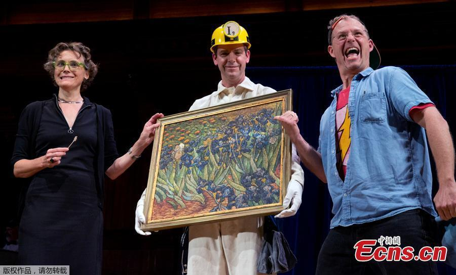 Research curator at Harvard Art Museums, Francesca Brewer (left) , reacts after cleaning a painting with saliva during the Ig Nobel award ceremonies at Harvard University in Cambridge, Mass., Thursday, Sept. 13, 2018. A team from Portugal who did not attend, won the award for chemistry for measuring the degree to which human saliva is a good cleaning agent for dirty surfaces. 