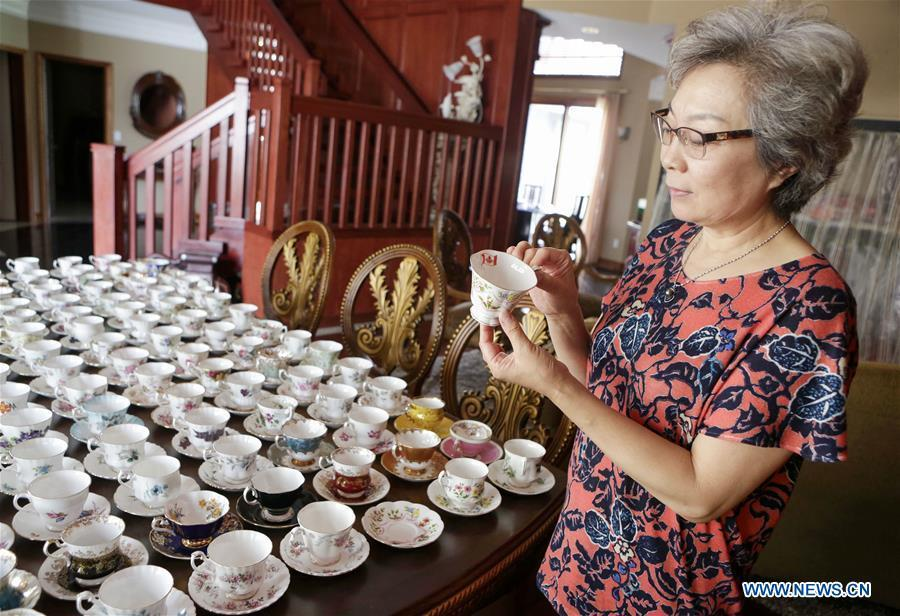 Teacup collector June Gao displays part of her teacup collections inside her house in Vancouver, Canada, Sept. 13, 2018. (Xinhua/Liang Sen)