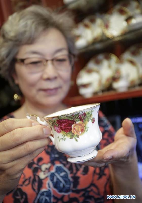 Teacup collector June Gao displays one of her teacup collections at her house in Vancouver, Canada, Sept. 13, 2018. (Xinhua/Liang Sen)