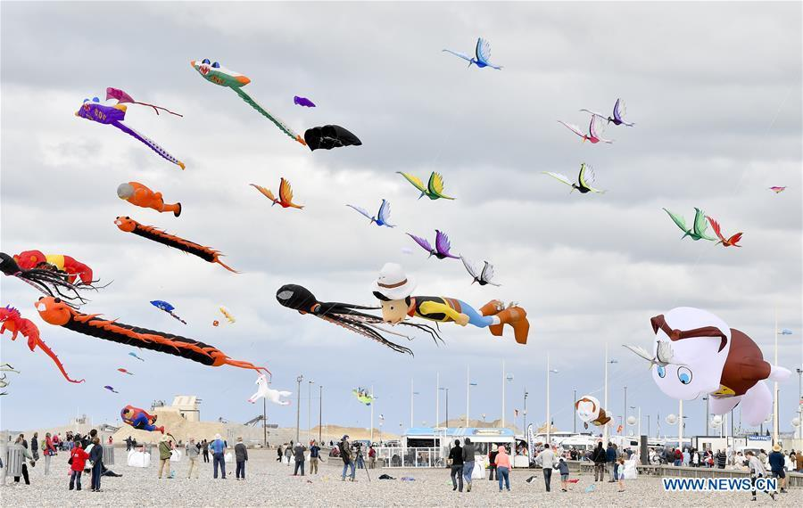 Kites fly over Dieppe, France, on Sept. 14, 2018. The 20th Dieppe International Kite Festival is held here from Sept. 8 to Sept. 16, attracting over 1,000 kite enthusiasts from 34 countries and regions. (Xinhua/Chen Yichen)
