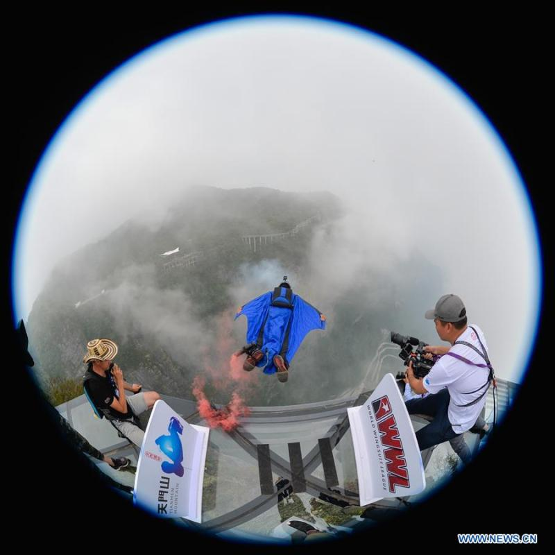 <?php echo strip_tags(addslashes(Sven Ugua of Belgium competes during the World Wingsuit League China Grand Prix in Zhangjiajie, central China's Hunan Province, Sept. 15, 2018. (Xinhua/Zhang Xiaoyu))) ?>