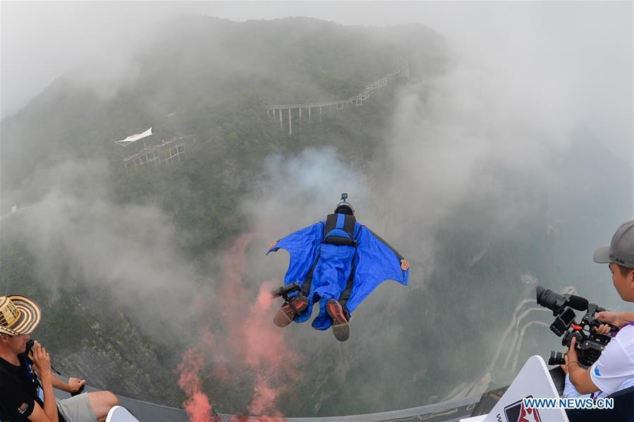 <?php echo strip_tags(addslashes(Gabriel Lott of Brazil competes during the World Wingsuit League China Grand Prix in Zhangjiajie, central China's Hunan Province, Sept. 15, 2018. (Xinhua/Zhang Xiaoyu))) ?>
