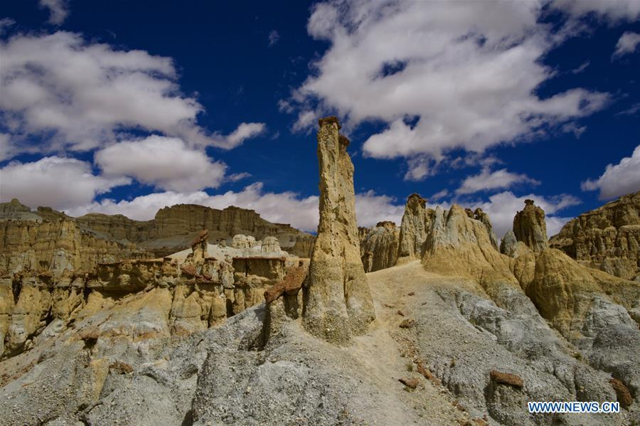 Photo taken on Sept. 11, 2018 shows the scenery of Xiayigou Earth Forest in Zanda County of Ali, southwest China\'s Tibet Autonomous Region. Settled along the Xiangquan River in the county, the well-preserved Earth Forest appears colorful especially under direct sunlight due to the ore contained. (Xinhua/Purbu Zhaxi)
