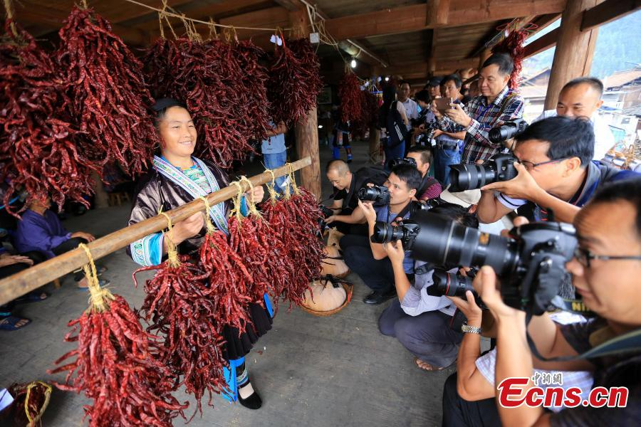 A pepper contest is held at a Miao village in Rongshui Miao Autonomous County, Southwest China's Guangxi Zhuang Autonomous Region, Sept. 16, 2018. More than 40 Miao women brought their own peppers to participate in the contest to select the best one. Pepper planting has become an important industry for poverty alleviation in the village. (Photo: China News Service/Shi Feng)