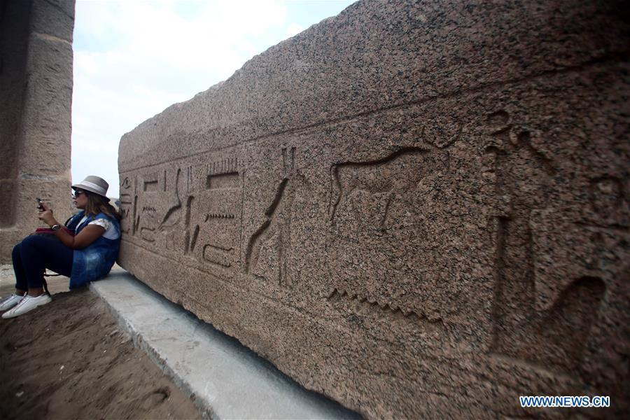 A woman rests in an open-air museum in Sharqiya, Egypt, on Sept. 15, 2018. Some 130 kilometers away from the Egyptian capital Cairo, work continued to revive the north capital of ancient Egypt, San al-Hagar or Tanis and to turn it into an open-air museum. (Xinhua/Ahmed Gomaa)