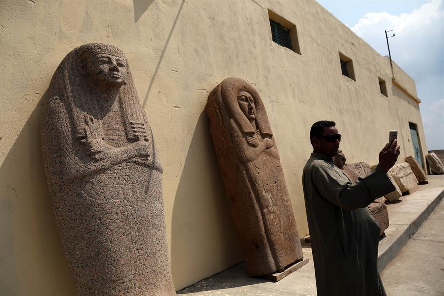 A man takes selfies in an open-air museum in Sharqiya, Egypt, on Sept. 15, 2018. Some 130 kilometers away from the Egyptian capital Cairo, work continued to revive the north capital of ancient Egypt, San al-Hagar or Tanis and to turn it into an open-air museum. TO GO WITH Feature: Egypt to turn Tanis archaeological site into open-air museum (Xinhua/Ahmed Gomaa)