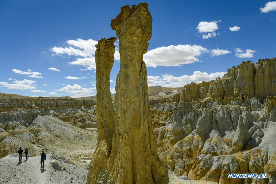 Photo taken on Sept. 14, 2018 shows the scenery of Xiayigou Earth Forest in Zanda County of Ali, southwest China\'s Tibet Autonomous Region. Settled along the Xiangquan River in the county, the well-preserved Earth Forest appears colorful especially under direct sunlight due to the ore contained. (Xinhua/Liu Dongjun)