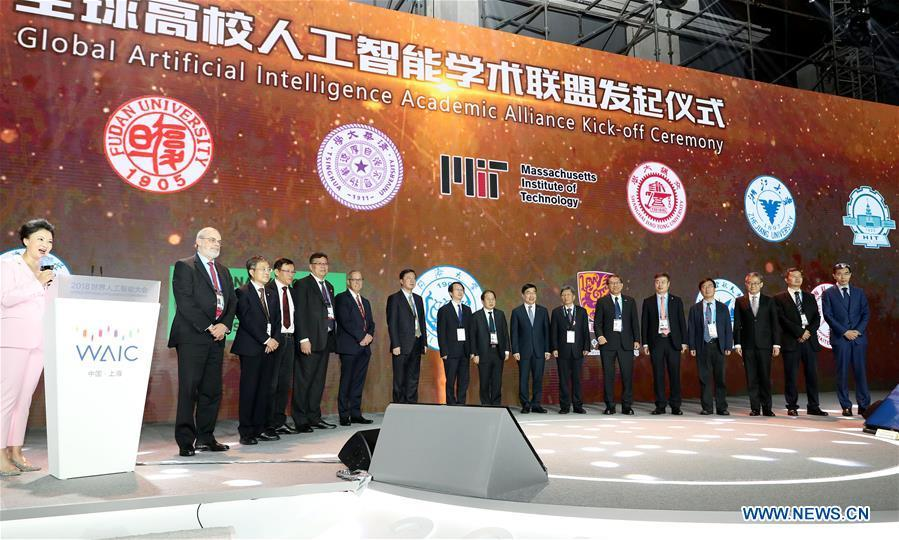 Guests attend a global artificial intelligence academic alliance kick-off ceremony during the World Artificial Intelligence Conference (WAIC) 2018 in Shanghai, east China, Sept. 17, 2018. The three-day conference has attracted experts, scholars and entrepreneurs from nearly 40 countries and regions. More than 200 leading companies in AI participated in the conference and the exhibition. (Xinhua/Fang Zhe)