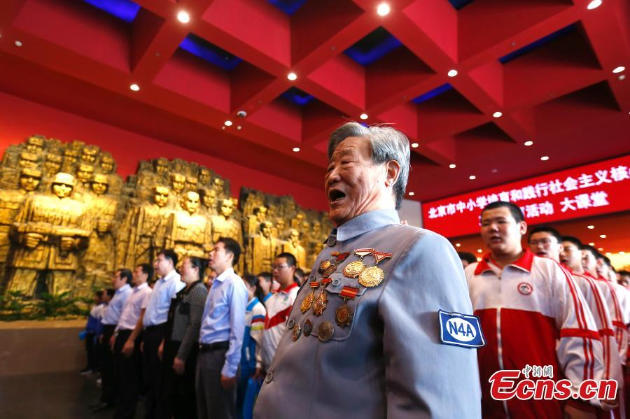 The 94-year-old New Fourth Army veteran Jiao Runkun salutes to martyrs at the Museum of the War of Chinese People\'s Resistance Against Japanese Aggression in Beijing, Sept. 18, 2018. On September 18, 1931, the Japanese Kwantung Army stationed in northeast China destroyed a section of the railway near Liutiaohu and then falsely accused the Chinese military of causing the explosion. Using this as a pretext, the Japanese then bombarded Shenyang and began invasion of northeast China.  (Photo: China News Service/Fu Tian)