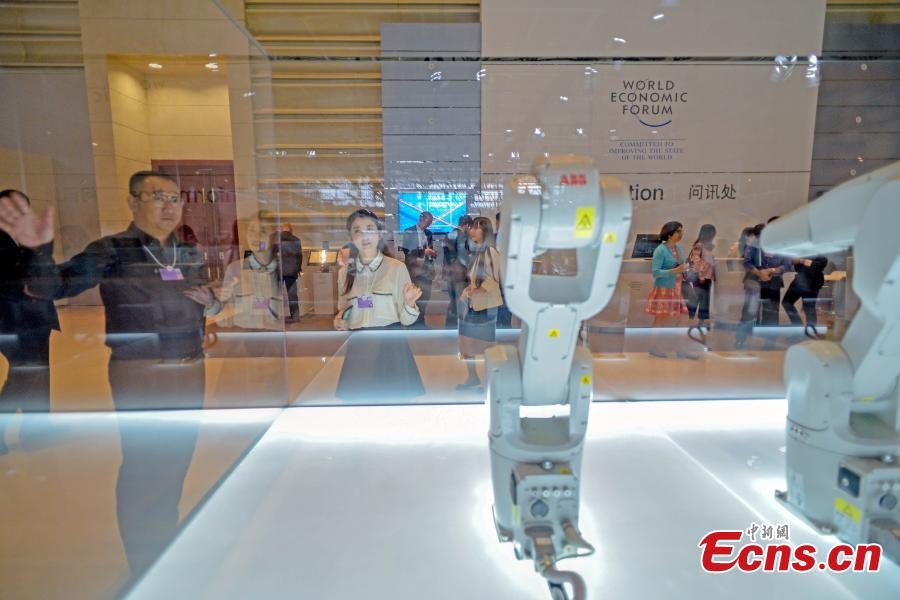 A visitor interacts with robot Manus at Summer Davos at Meijiang Convention and Exhibition Center in Tianjin, Sept. 17, 2018. The Annual Meeting of the New Champions of the World Economic Forum (WEF), also known as Summer Davos, kicked off on Tuesday in Tianjin. This year\'s forum will feature a theme of \