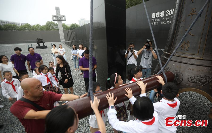 Visitors strike the Peace Bell at the Memorial Hall of the Victims in Nanjing Massacre by Japanese Invaders in Nanjing City, Jiangsu Province, Sept. 18, 2018. On September 18, 1931, the Japanese Kwantung Army stationed in northeast China destroyed a section of the railway near Liutiaohu and then falsely accused the Chinese military of causing the explosion. Using this as a pretext, the Japanese then bombarded Shenyang and began invasion of northeast China. (Photo: China News Service/Yang Bo)